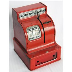 A TOY CASH REGISTER BANK. Coin slot at top, right. 11cm x 11cm x 15cm in height. Red metal. Fine.