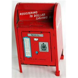 A TOY MAIL BOX BANK. CANADA MAIL. REGISTERING $10.00 SAVINGS BANK. Mail box shaped, with coin slot o