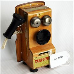 TALK-O-PHONE BANK. Shaped like an Antique Wall Phone. Coin slot at lower front. 8cm x 10cm x 18cm. T