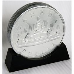 CANADA DOLLAR/VOYAGEUR SILVER DOLLAR. Coin shape/on base. Coin slot on top. 15cm. In height. Silver