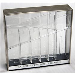 LA CAISSE POPULAIRE DESJARDINS. A rectangular clear plastic bank, with the coin slot on top. 17cm x