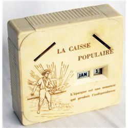 LA CAISSIE POPULAIRE. A rectangular Coin Calendar bank. Two coin slots in front. Currency slot on ba