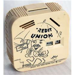 CREDIT UNION-A COIN CALLEDAR BANK. A rectangular Coin Calendar bank. Coin slots on top and front for