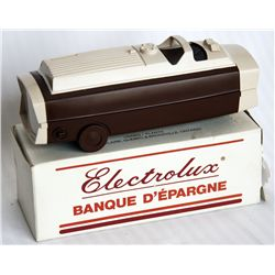 ELECTROLUX VACUUM CLEANER. (Large). Coin slot on time. 5cm x 4 1/2cm x 15cm long. Two tone brown pla