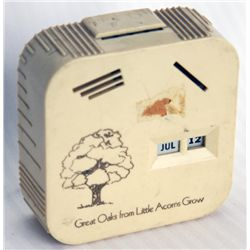 GREAT OAKS FROM LITTLE ACORNS GROW'. A rectangular Coin Calendar bank. Four coin slots on front, one