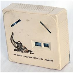 THE GREAT-WEST LIFE ASSURANCE COMPANY. A rectangular Coin Calendar bank. Two coin slots in front. Cu