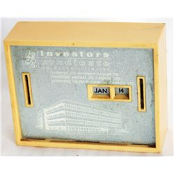 INVESTORS SYNDICATE OF CANADA LIMITED. A RECTANGULAR All Coin Calendar bank. Two coin slots on front