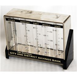 THE MONTREAL CITY AND DISTRICT SAVINGS BANK. A rectangular clear plastic bank with black highlights.