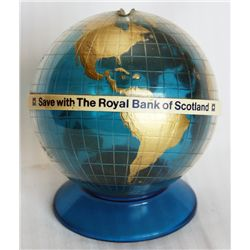 SAVE WITH THE ROYAL BANK OF SCOTLAND. A blue, gold and white plastic globe shaped bank. Coin slot on