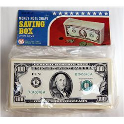 SAVINGS BOX. A plastic bank in the shape of a Stack of U.S. $100.00 Bills. Coin slot on top. Key pre