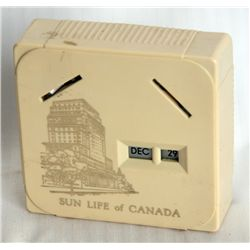 SUN LIFE OF CANADA. A rectangular Coin Calendar bank. Two coin slots on front. Currency slot on back