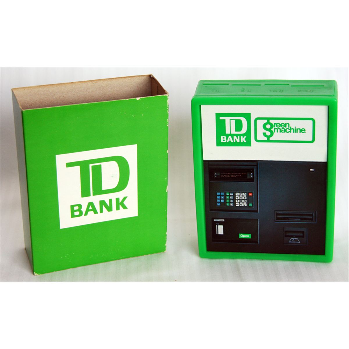 T D  BANK  Green Machine  A rectangular green plastic bank in the shape of  the T D green machine  Fo
