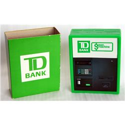 T.D. BANK. Green Machine. A rectangular green plastic bank in the shape of the T.D green machine. Fo