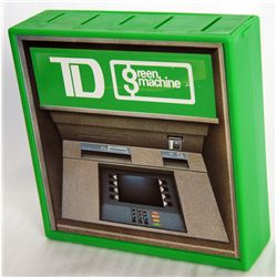 T.D. BANK. Green Machine. A rectangular green plastic bank in the shape of the T.D green machine. Fi