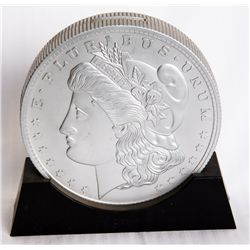U.S. MORGAN SILVER DOLLAR. (E. PLURIBUS UNUM). A coins shape on base, silver coloured plastic bank.