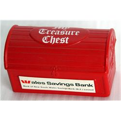WALES SAVINGS BANK/MY TREASURE CHEST. A 'treasure chest' shaped, red plastic bank. Coin slot on side