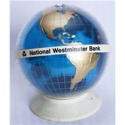 NATIONAL WESTMINSTER BANK (B.C.). A Globe Shaped, blue, gold & white plastic bank. Coin slot on top.