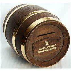 SEATTLE-FIRST NATIONAL BANK. Wine Barrel shaped. Coin slot on top. A wood appearing, plastic bank, w
