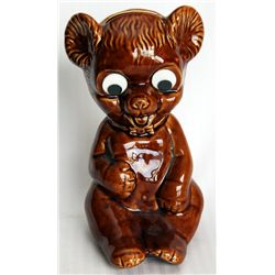 A Brown Ceramic Seated Bear Bank. Coin slot on top. 10cm x 12cm x 19cm. Made in England. VF.