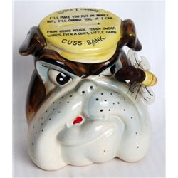 CUSS BANK. A Ceramic bulldog head shaped bank, Slot on top for 'Temper Charges'. 1cm x 13cm x8cm. Br