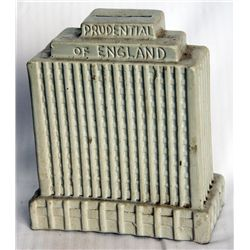 PRUDENTIAL OF ENGLAND. Ceramic Bank Building bank. Coin slot on top. 15cm x 17cm x 7cm. White. VF.