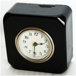 A box shaped Clock Bank. Separate slots for 10, 25 Cents at top, and banknotes on the side. 10cm x 1