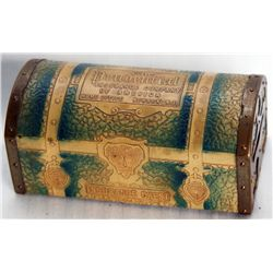 THE PRUDENTIAL INSURANCE COMPANY OF AMERICA, NEWARK, N.J. A treasure chest shaped bank. Coin slot on