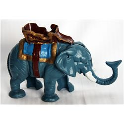 A Mechanical bank shaped like an Elephant. Trunk shots coin into slot on back. 16cm x 13cm x 6cm. Ca