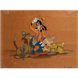 Pinocchio promotion cel of Goofy, Dopey and Gideon on wooden background