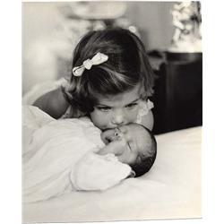 Richard Avedon portrait of Caroline Kennedy kissing John F. Kennedy, Jr.