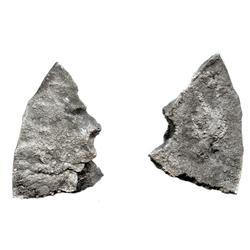 "Irregular (triangular) cut piece broken off the edge of a thin silver ""splash"" ingot, 2.33 troy oz.,"