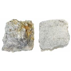 Tin ingot, neatly formed, encrusted as found.