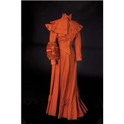 Eva Gabor  three-piece sienna wool button-front suit with capelet, muff, and tie from Gigi