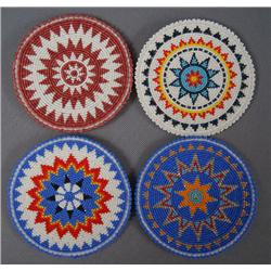 COLLECTION OF PLAINS BEADED ROSETTES