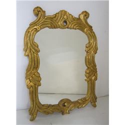 20th c. Scroll design framed gilt wood mirror