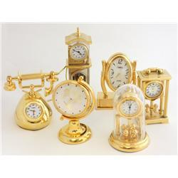 6 miniature brass clocks