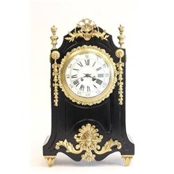 Baroque bronze mounted black wood clock