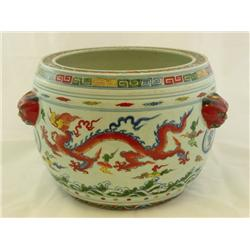 Jardiniere with mask handles & dragon design