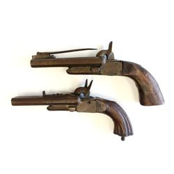2 antique double barreled handguns