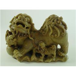 Stone lion with 2 small lions